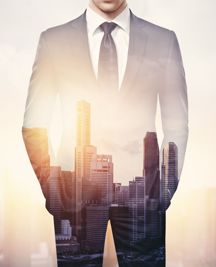 double exposure of businessman and modern city